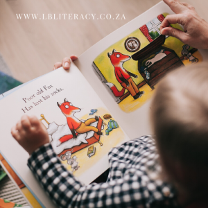A young child is reading a story with his mom about a fox.