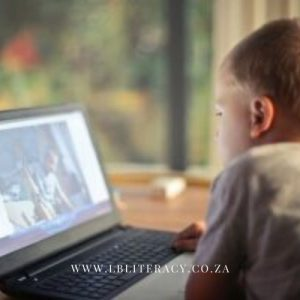 A young boy watches a video on a laptop with no restriction on screen time.