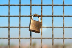 Lockdown in Johannesburg (a lock on a fence)