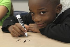 A boy doing math calculations using his working memory. www.LBLiteracy.co.za